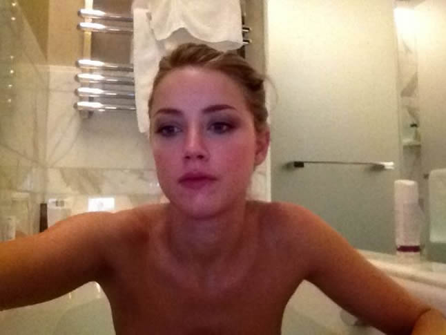 Amber Heard posing nude at her bath
