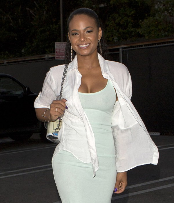 Christina Milian Braless in Tight White Top Photo