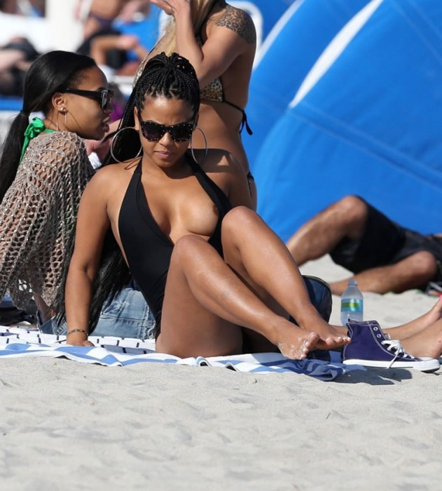Christina Milian nip slip at the beach