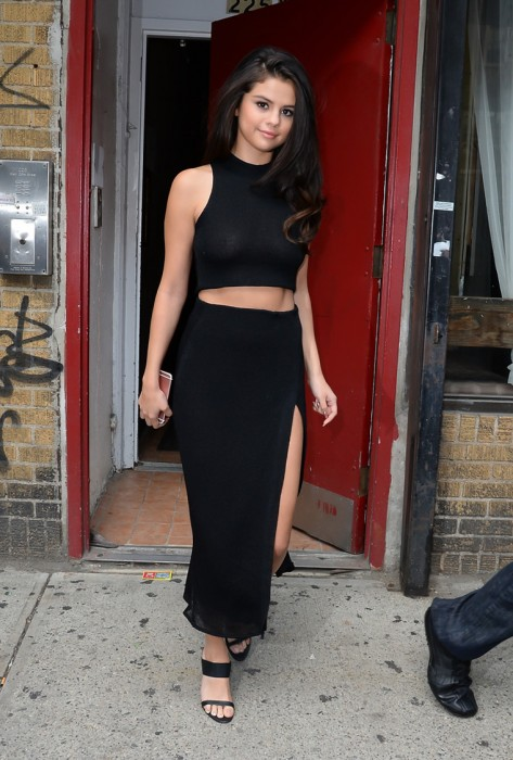 Selena Gomez Braless in See Through Black Top