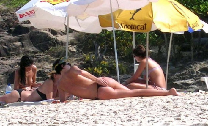 Charlize Theron Topless at the beach