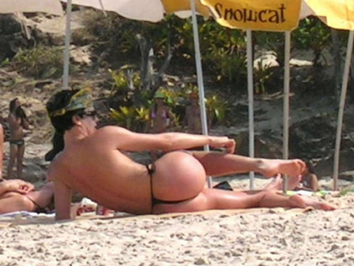 Charlize Theron Topless at the beach Booty