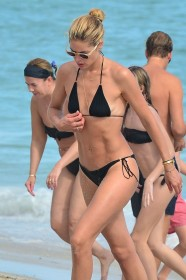 3 Jan 2017 - Miami Beach - America Doutzen Kroes was wearing a black bikini at the beach. Concerned about her son, the mother of two slip on buoys around her son's arms and kept a watchfull eye on the young boy. BYLINE MUST READ : XPOSUREPHOTOS.COM ***UK CLIENTS - PICTURES CONTAINING CHILDREN PLEASE PIXELATE FACE PRIOR TO PUBLICATION *** **UK CLIENTS MUST CALL PRIOR TO TV OR ONLINE USAGE PLEASE TELEPHONE 44 208 344 2007 ***