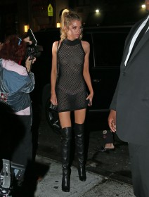 Sexy Stella Maxwell Braless in a see through dress