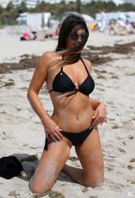 Claudia Romani in bikini photos