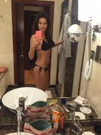 Melanie Sykes in black bikini home photo